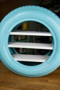 https://spaceshipsandlaserbeams.com/blog/party-crafts-and-diy/diy-toy-shelves-from-a-used-tire